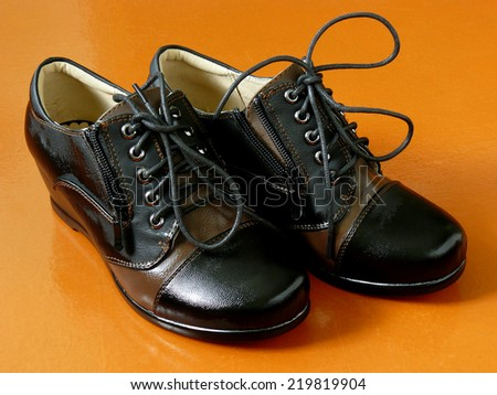 pair of female autumnal shoes with laces - stock photo