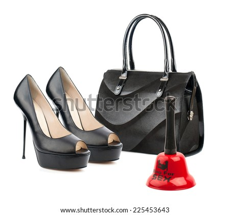 Pair of female shoes,handbag and red bell isolated on white.