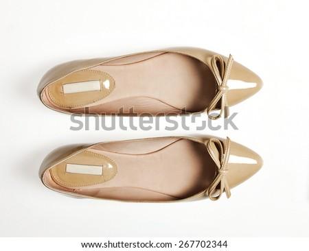 Pair of female summer shoe on white background - stock photo