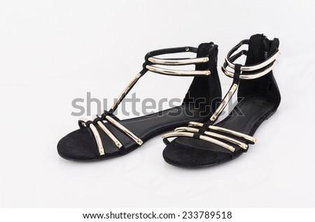 Pair of female summer tape black sandals on white background - stock photo
