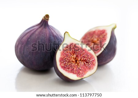 pair of figs, one of them sliced - stock photo