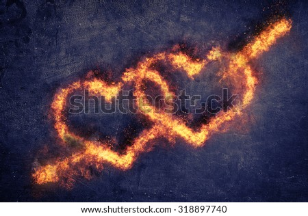 Pair of flaming overlapping Valentines hearts pierced by Cupids arrow of Love over a dark textured background with copyspace for your romantic message - stock photo