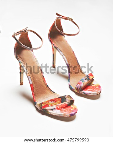 pair of floral women shoes isolated with shadows