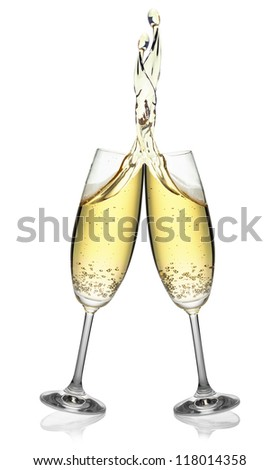 Pair of flutes making an elegant splash of champagne, isolated on the white background, clipping path included. - stock photo