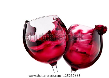 Pair of glass with red wine splash
