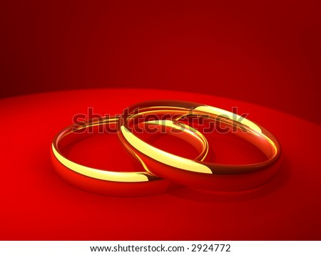 Pair of gold wedding rings laying on a red background