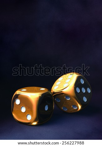 Pair of golden dice side by side , dark violet background - stock photo