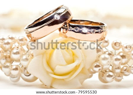 Pair of golden wedding rings. Isolated on white - stock photo