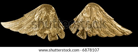 Pair of golden wings over black - stock photo