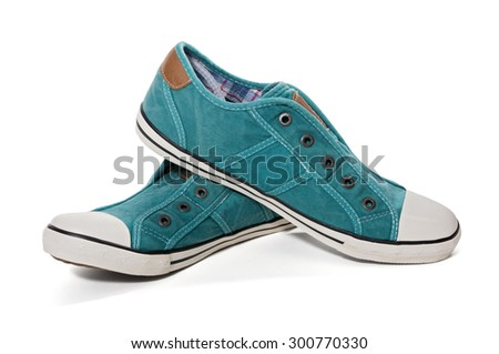 Pair of green canvas sneakers isolated on white background - stock photo