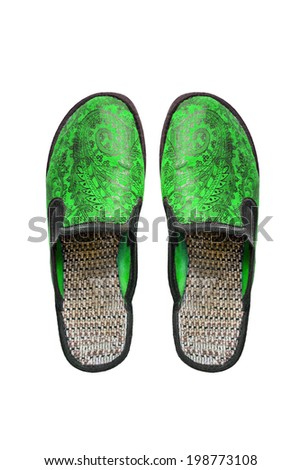 Pair of green home slippers isolated over white - stock photo