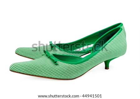 pair of green shoes on white background