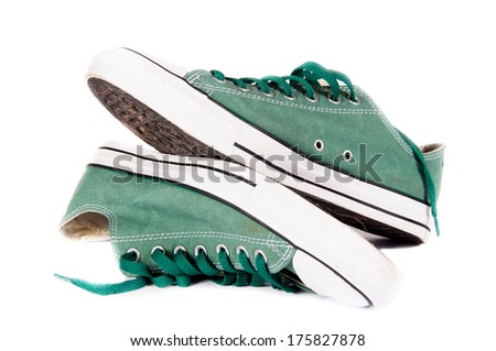 Pair of green sneakers isolated on white background - stock photo