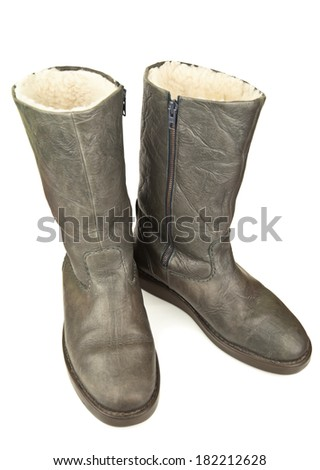 pair of grey boots on white background