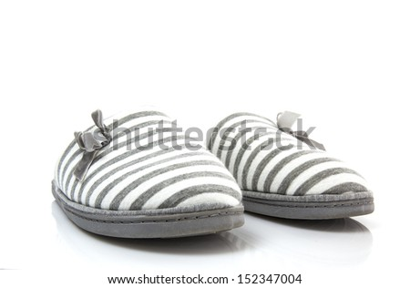 Pair of grey slippers on a white background - stock photo