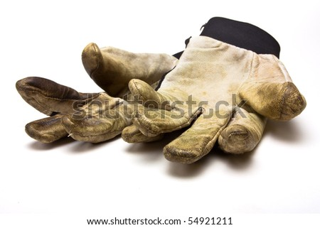 Pair of grubby gardening gloves from low perspective isolated against white background. - stock photo