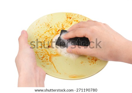 Pair of hands washing dirty plate - stock photo