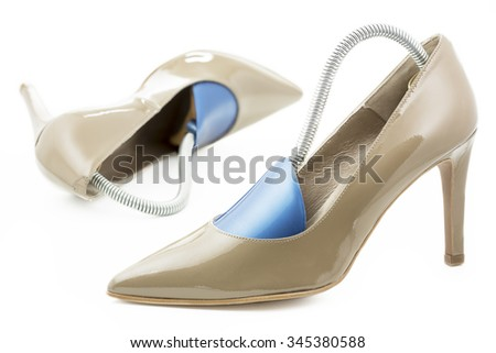 Pair of high heels with shoe formers - stock photo