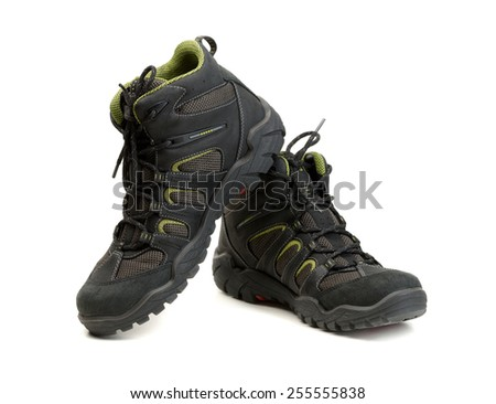 Pair of high-tech waterproof winter boots trekking. Isolate on white. - stock photo