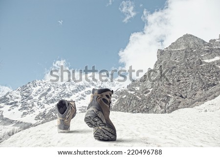 Pair of hikers boots walking on path - stock photo