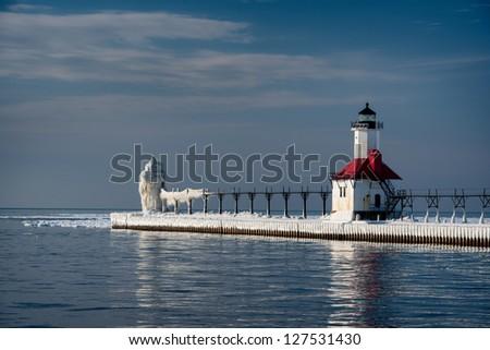 Pair of historic lighthouses on Lake Michigan in Saint Joseph, Michigan during Winter - stock photo