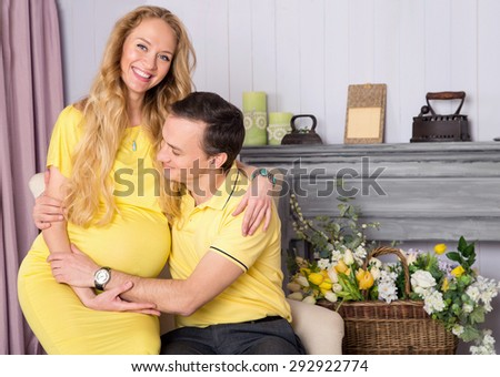Pair of husband and wife. Woman is pregnant, they are expecting a baby together. Couple of happy people. Happy family in anticipation of the birth of the baby. Woman on the ninth month of pregnancy. - stock photo