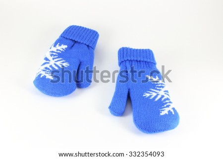 Pair of knitted mittens with pattern snowflake, isolate on white