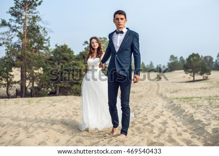 pair of lovers on the shore of a lake in summer Sunny weather