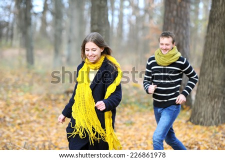 Pair of loving hearts walk in the autumn park - stock photo