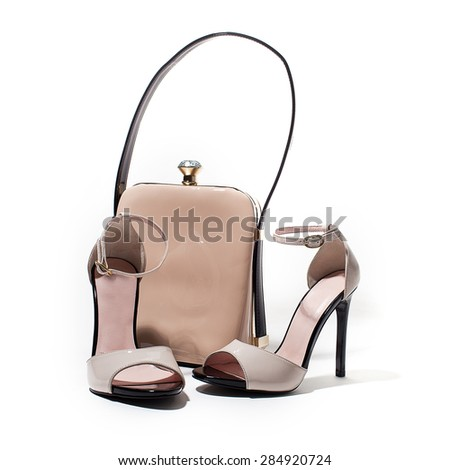 Pair of luxurious women summer shoes with a shine bad isolated on white background - stock photo