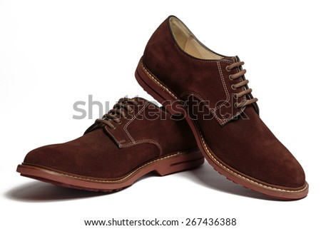 Pair of male classic brown suede shoes isolated on the white background - stock photo