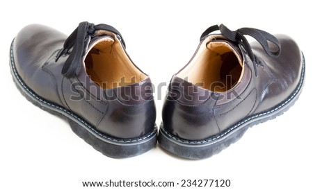 pair of men's black leather black shoes - stock photo