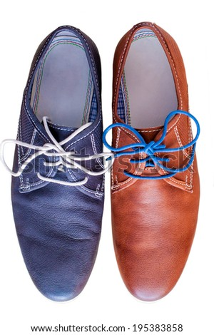 Pair of men's leather shoes. Each in different color. - stock photo