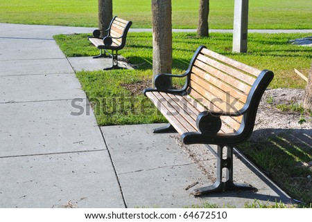 Pair of metal and wooden benches at a beach park in St. Petersburg, Florida - stock photo