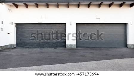 Pair of modern garage doors. Large automatic up and over garage doors for a wealthy holiday home. - stock photo