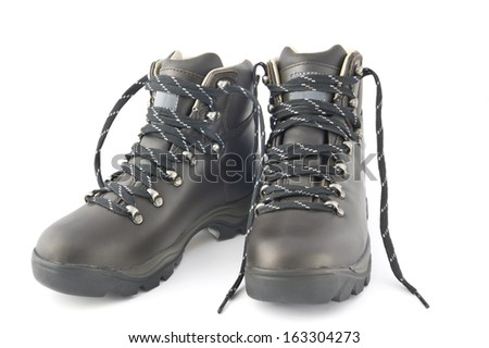 Pair of new black hiking boots isolated on white.