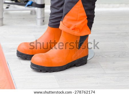 Pair of new protective gummy boots for industrial workers - stock photo