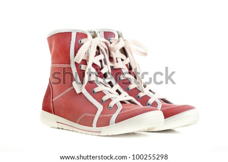 Pair of new red sneakers isolated on white background - stock photo