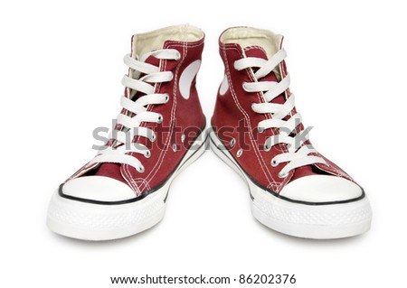 Pair of  new red sneakers isolated on white background