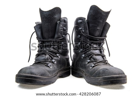 Pair of old army boots with untied laces on a white background/Pair of military boots