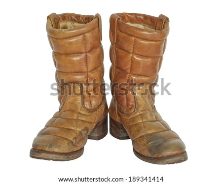 Pair of old boots on white background.