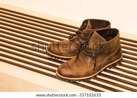 Pair of old yellow working boots - stock photo