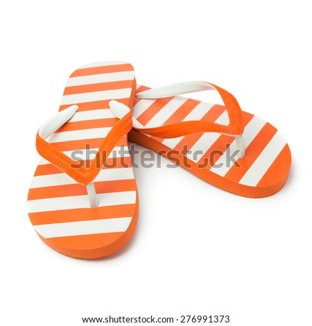 Pair of orange striped sandal on white background