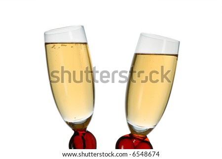 Pair of original wine glasses with champagne isolated on white background