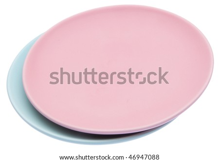 Pair of pastel colored plates isolated on white with a clipping path.