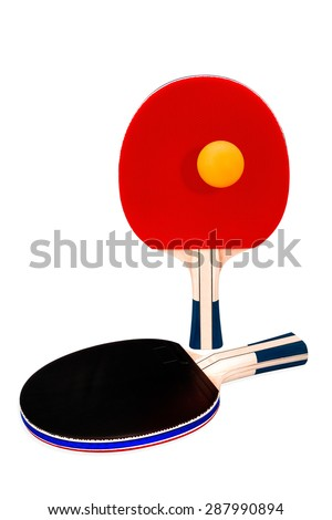 Pair of ping-pong rackets and orange ball on white isolated background with clipping path. - stock photo