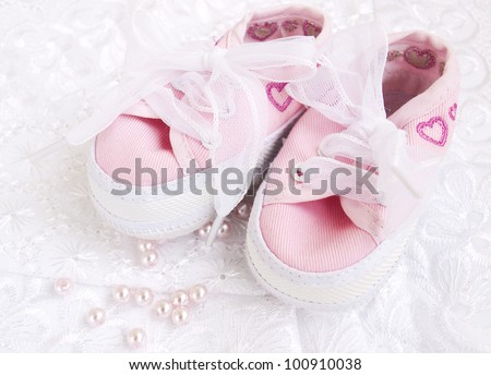 Pair of pink  Babies shoes with  pearls
