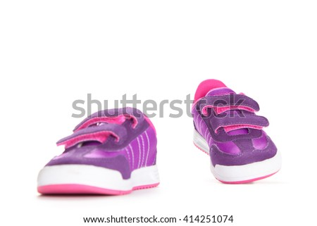 Pair of pink sport shoes on white background.kids shoes.