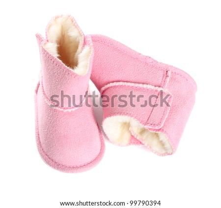 Pair of pink winter boots over pure white background