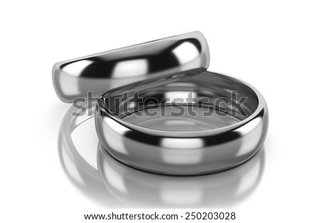Pair of platinum wedding rings isolated on white background